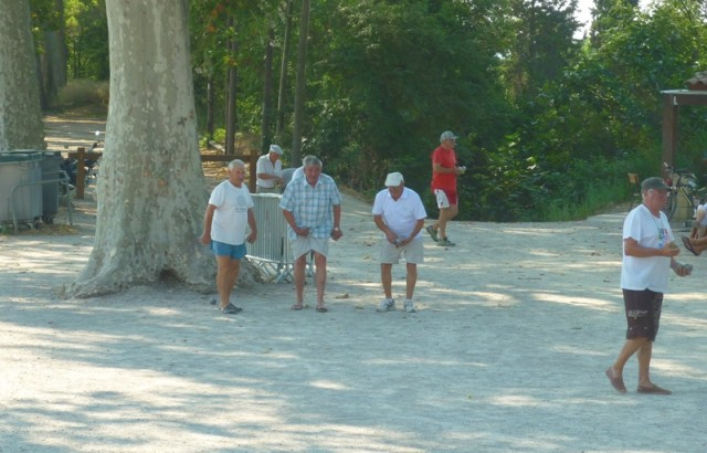Playing boules beside the canal in Colombiers