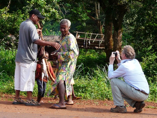 Didier buying bushmeat on the roadside